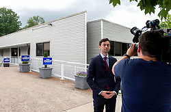 June 12, 2017 - Sandy Springs, Georgia, U.S. -  JON OSSOFF, the Democratic candidate for Congress in Georgia's Sixth District, takes a moment for himself as CBS photographer ERIN COKER checks her light levels before an interview outside Ossoff's Sandy Springs field office.  Ossoff is competing against Republican candidate Karen Handel forthe open Congressional seat in a special election on June 20.(Credit Image: © Brian Cahn via ZUMA Wire)