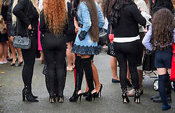 © Licensed to London News Pictures. 26/10/2017. Epsom, UK. A group of women in high heels attend the funeral of Tom 'Tomboy' Doherty the nephew of Big Fat Gypsy Weddings star Paddy Doherty, at Epsom Cemetery in Epsom, Surrey. Tom Doherty was 17 when he was killed in a car crash in South Nutfield in Surrey on October 9. He had passed his driving test just days earlier. Photo credit: Ben Cawthra/LNP