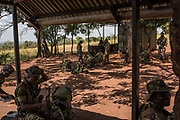 Garamba Rangers and members The Armed Forces of the Democratic Republic of the Congo (FARDC) sit at a camp at the Bagunda outpost in Garamba National Park on November 28, 2017.