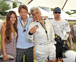 Left to right, JESSICA MICHIBATA, JENSON BUTTON, JAY LENO and JESSE JAMES husband of Sandra Bullock at a luncheon hosted by Cartier for their sponsorship of the Style et Luxe part of the Goodwood Festival of Speed at Goodwood House, West Sussex on 5th July 2009.
