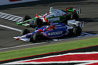 Dario Franchitti races Tony Kanaan at the California Speedway, Toyota Indy 400, October 16, 2005
