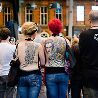 Manchester, UK - 4 August 2012: two tattooed girls attend the Manchester Tattoo Show, one of the most popular conventions of the UK tattoo community.