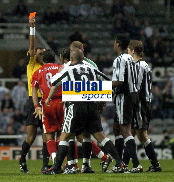 Photo. Glyn Thomas. <br /> Newcastle United v Hapoel Bnei Sakhnin. <br /> UEFA Cup, 1st round, 1st leg. 16/09/2004.<br /> Referee Antonio Costas (L) shows Abas Swan the red card after a scuffle with Newcastle's Nicky Butt. Butt was also sent off<br /> NORWAY ONLY