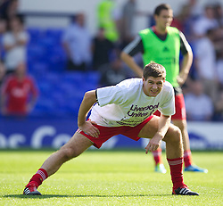 LIVERPOOL, ENGLAND - Saturday, October 1, 2011: Liverpool's captain Steven Gerrard MBE warms-up wearing a Liverpool Unites t-shirt before the Premiership match against Everton at Goodison Park. (Pic by Vegard Grott/Propaganda)