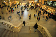 An overview of Grand Central Station with passengers hurrying to their destination