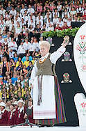 Lithuanian Song Celebration (Song and Dance Festival) 90th anniversary, Vilnius, Lithuania (6 July 2014). Pictured here, Lithuanian President Dalia Grybauskaite gives a short speech at the Song Day in Vingis Park, Vilnius. The Song Celebration in Vilnius is Lithuania's greatest cultural event, occurring only once every four years, and along with similar festivals in Latvia and Estonia, is inscribed on the UNESCO list of Intangible Cultural Heritage. © Rudolf Abraham.