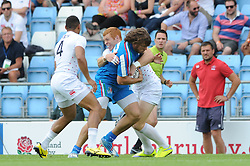 James Rodwell of England tackles Jacopo Salvetti of Italy - Photo mandatory by-line: Dougie Allward/JMP - Mobile: 07966 386802 - 11/07/2015 - SPORT - Rugby - Exeter - Sandy Park - European Grand Prix 7s