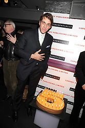 BEN ELLIOT and cake at the Quintessentially Christmas Party held at Kitts, Sloane Square, London on 2nd December 2008.