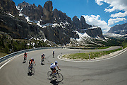 During stages in the Dolomites, cycling fans took to the on their own two wheels--here, a group from Thomson Tours spins through the Sella Ronda group.