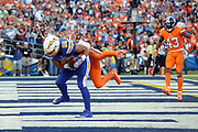 San Diego Chargers tight end Hunter Henry (86) is jumped on by leaping Denver Broncos cornerback Chris Harris, Jr. (25) as Henry catches a 5 yard first quarter touchdown pass that gives the Chargers a 7-0 lead during the 2016 NFL week 6 regular season football game against the Denver Broncos on Thursday, Oct. 13, 2016 in San Diego. The Chargers won the game 21-13. (©Paul Anthony Spinelli)