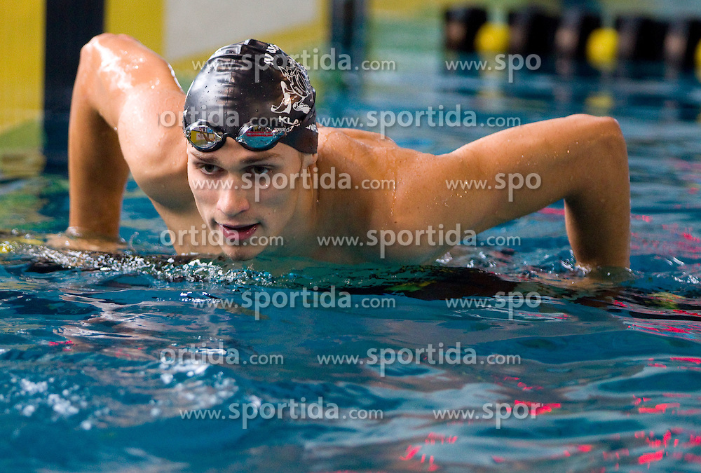 Christian Zluga of Austria after he competed during the Men's 100 m Backstroke Final during Slovenia Open swimming Championship and MM Kranj 2011, on June 4, 2011 in Olympic pool, Kranj, Slovenia. (Photo By Vid Ponikvar / Sportida.com)