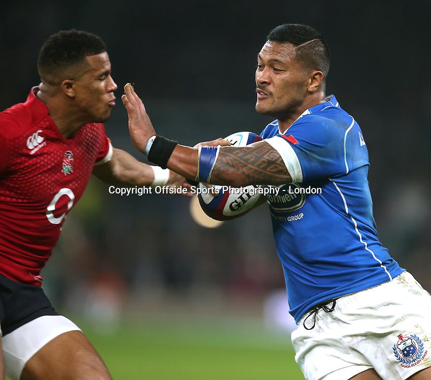 22 November 2014 International Rugby Union - England v Samoa;   John Leota of Samoa hands off the challenge of Anthony Watson.<br /> Photo: Mark Leech