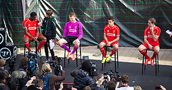 LIVERPOOL, ENGLAND - Thursday, April 10, 2014: Liverpool players Kolo Toure, goalkeeper Simon Mignolet, Philippe Coutinho Correia and Jordan Henderson at the launch of the new Warrior home kit for 2014/2015 at the Liverpool One shopping centre. (Pic by David Rawcliffe/Propaganda)