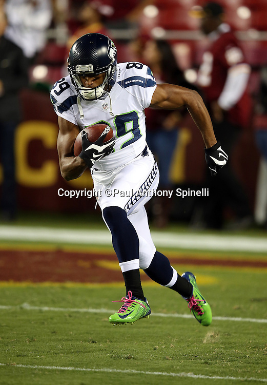 Seattle Seahawks wide receiver Doug Baldwin (89) returns a kick while warming up before the NFL week 5 regular season football game against the Washington Redskins on Monday, Oct. 6, 2014 in Landover, Md. The Seahawks won the game 27-17. ©Paul Anthony Spinelli