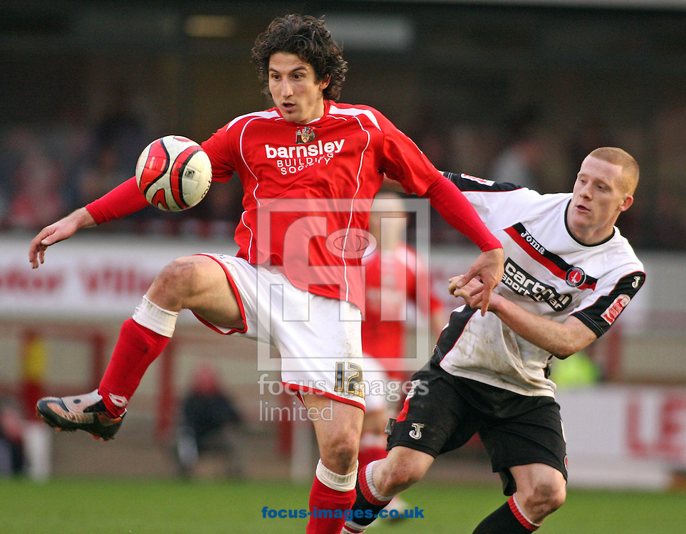 Barnsley - Saturday 21st February 2009 : Andranik Teymourian of Barnsley & Nicky Bailey of Charlton Athletic in action during the Coca Cola Championship match at Oakwell, Barnsley. (Pic by Steven Price/Focus Images)