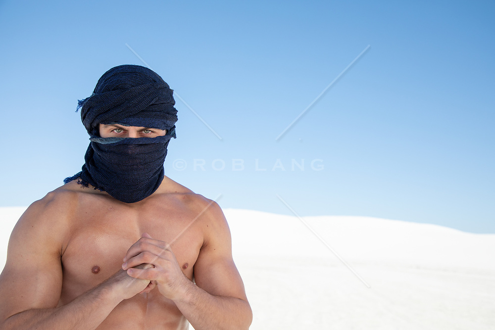hot shirtless man with green eyes wrapped in a scarf