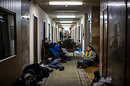 KIEV, UKRAINE - DECEMBER 4: People rest in a corridor of the Professional Trade Unions building, which is controlled by anti-government protesters, on December 4, 2013 in Kiev, Ukraine. Thousands of people have been protesting against the government since a decision by Ukrainian president Viktor Yanukovych to suspend a trade and partnership agreement with the European Union in favor of incentives from Russia. (Photo by Brendan Hoffman/Getty Images) *** Local Caption ***