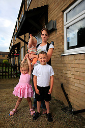 UK ENGLAND KENT GRAVESEND 2JUL08 - Maxine King and her children Jack, Ella & Toby pose in front of her reposessed house in Gravesend, Kent...jre/Photo by Jiri Rezac..© Jiri Rezac 2008..Contact: +44 (0) 7050 110 417.Mobile: +44 (0) 7801 337 683.Office: +44 (0) 20 8968 9635..Email: jiri@jirirezac.com.Web: www.jirirezac.com..© All images Jiri Rezac 2008 - All rights reserved.