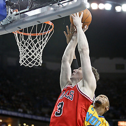 February 12, 2011; New Orleans, LA, USA; Chicago Bulls center Omer Asik (3) shoots over New Orleans Hornets power forward David West (30) during the third quarter at the New Orleans Arena.  The Bulls defeated the Hornets 97-88. Mandatory Credit: Derick E. Hingle