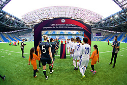 ASTANA, KAZAKHSTAN - Sunday, September 17, 2017: Wales and Kazakhstan players walk onto the pitch before the FIFA Women's World Cup 2019 Qualifying Round Group 1 match between Kazakhstan and Wales at the Astana Arena. (Pic by David Rawcliffe/Propaganda)