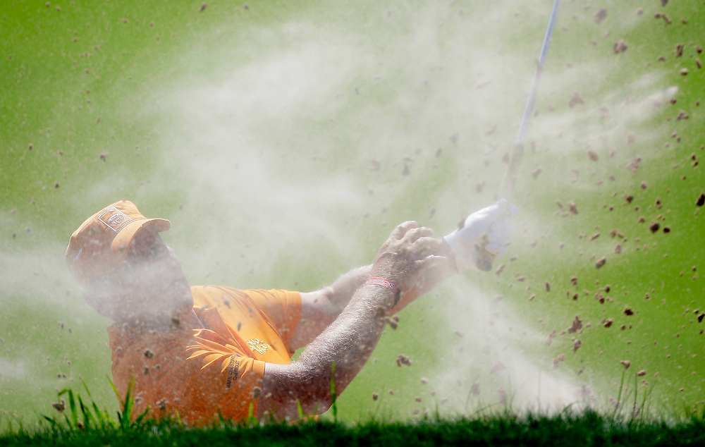 pga13, lynn, spt, 6.-John Daly tries to blast out of a trap in the 11th hole during the first round of the PGA Championship at Whistling Straits in Haven Wi Thursday August 12, 2010.  Photo by Tom Lynn/TLYNN@JOURNALSENTINEL.COM