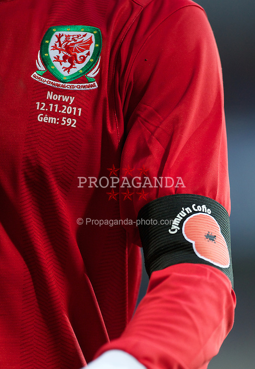 CARDIFF, WALES - Saturday, November 12, 2011: Wales' Gareth Bale, wearing a red poppy on a black armband, in action against Norway during the international friendly match at the Cardiff City Stadium. (Pic by David Rawcliffe/Propaganda)