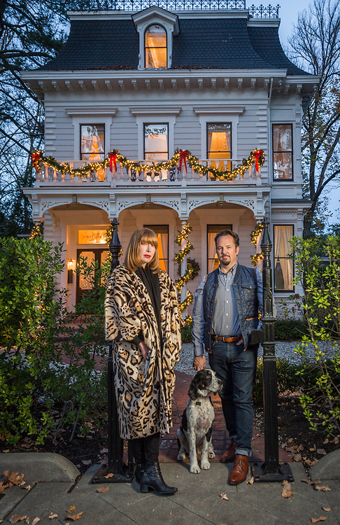 """Stylist Sabra Temple and realestate agent Paul Thienes with their dog, Teddy, pause at their front gate  of their historic house on Cedar Street in Calistoga.  """"We wanted to buy this house for ten years and we finally got it last January."""""""
