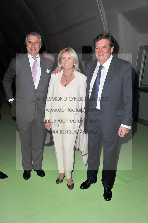 Left to right, ARNAUD BAMBERGER and MR & MRS JOHANN RUPERT he is chairman of Richemont at a dinner hosted by Cartier in celebration of the Chelsea Flower Show held at Battersea Power Station, 188 Kirtling Street, London SW8 on 23rd May 2011.