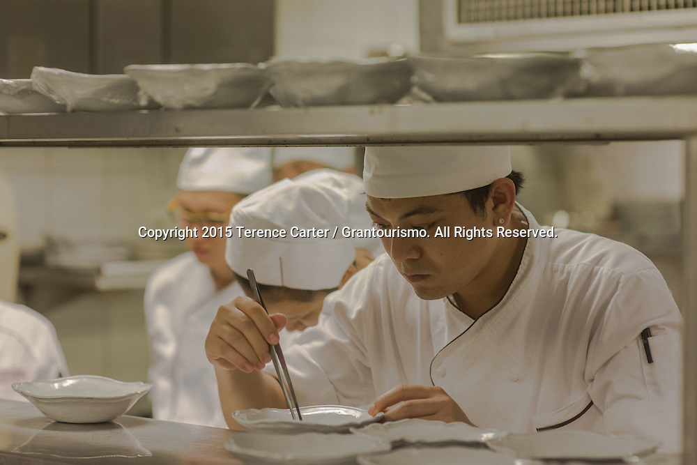 After being told *exactly* how Chef Thomas wants the plates, this young chef goes over each plate, all 80 of them, making sure they are just as the chef wants it. Copyright 2015 Terence Carter / Grantourismo. All Rights Reserved.
