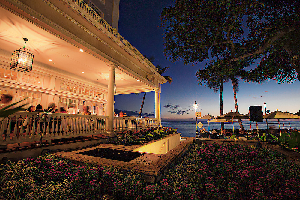 Diner on the lanai at the Moana Hotel in Waikiki beach, Hawaii