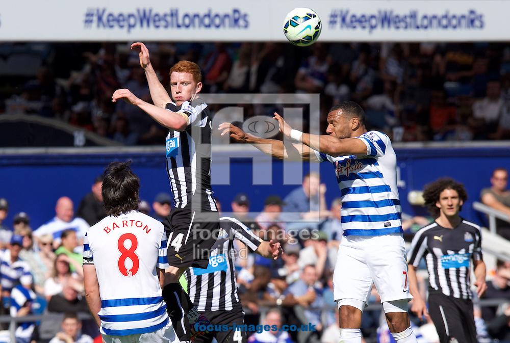 Jack Colback of Newcastle United wins the header from Matt Phillips of Queens Park Rangers during the Barclays Premier League match at the Loftus Road Stadium, London<br /> Picture by Alan Stanford/Focus Images Ltd +44 7915 056117<br /> 16/05/2015
