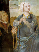 Christ's Passion (Triptych known as Altarpiece of St Antony) Detail: Male and female (Virgin Mary?) figures in prayer looking upwards.  Anonymous 16th century: Oil on wood. Church of St Nicolas, Tallin.