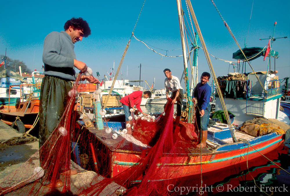 TURKEY, ISTANBUL, BOSPHORUS fishermen prepare nets before leaving the small fishing village of Rumelikavagi on the European shore