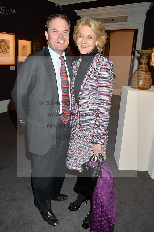 LORD DALMENY and FIONA SHACKLETON at a private view of Made in Britain featuring contents from The Ivy sold to benefit Child Bereavement UK held at Sotheby's, 34-35 New Bond Street, London on 23rd March 2015.