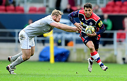 Gavin Henson of Bristol Rugby evades the challenge of Ross Batty of Bath Rugby - Mandatory by-line: Joe Meredith/JMP - 26/02/2017 - RUGBY - Ashton Gate - Bristol, England - Bristol Rugby v Bath Rugby - Aviva Premiership