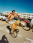 Smiling guy doing a wheelie on his bike, Ibiza, 2000