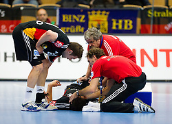 20.01.2011, Kristianstad Arena, SWE, IHF Handball Weltmeisterschaft 2011, Herren, Deutschland vs Tunesien, im Bild, // An injured German player // during the IHF 2011 World Men's Handball Championship match Germany vs Tunisia  at Kristianstad Arena, Sweden on 20/1/2011. EXPA Pictures © 2011, PhotoCredit: EXPA/ Skycam/ Henrik Johansson +++++ ATTENTION - OUT OF SWEDEN/SWE +++++