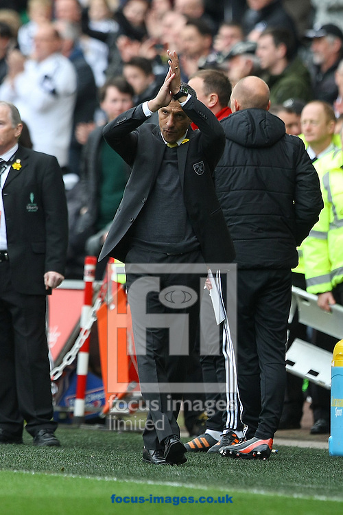 Norwich Manager Chris Hughton applauds the traveling support at the end of the Barclays Premier League match at the Liberty Stadium, Swansea<br /> Picture by Paul Chesterton/Focus Images Ltd +44 7904 640267<br /> 29/03/2014