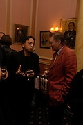 Kazuo Ishiguro and Michael Holroyd. Book party for 'Saturday' by Ian McEwan, Polish Club, South Kensington.  4 February 2005. ONE TIME USE ONLY - DO NOT ARCHIVE  © Copyright Photograph by Dafydd Jones 66 Stockwell Park Rd. London SW9 0DA Tel 020 7733 0108 www.dafjones.com
