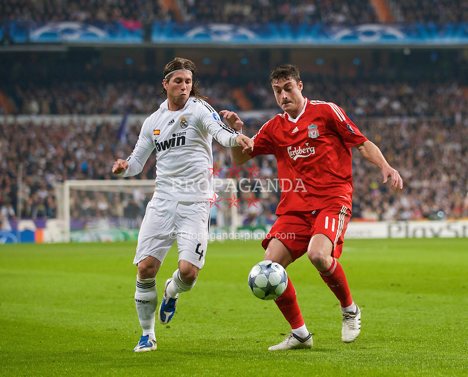 MADRID, SPAIN - Wednesday, February 25, 2009: Liverpool's Albert Riera and Real Madrid's Sergio Ramos during the UEFA Champions League First Knock-Out Round at the Santiago Bernabeu. (Photo by David Rawcliffe/Propaganda)