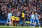 Burnley defender Michael Keane celebrates his last minute equaliser in front of the travelling fans during the Sky Bet Championship match between Brighton and Hove Albion and Burnley at the American Express Community Stadium, Brighton and Hove, England on 2 April 2016. Photo by Bennett Dean.
