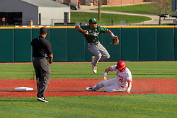 NORMAL, IL - April 08: Umpire Wayne Harris watches the action as Jordan Libman slides at 2nd base and a leap by Keith Torres as he tries to make a double play throw to first during a college baseball game between the ISU Redbirds  and the Sacramento State Hornets on April 08 2019 at Duffy Bass Field in Normal, IL. (Photo by Alan Look)