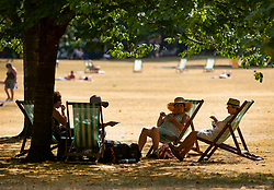 © Licensed to London News Pictures. 26/07/2018. London, UK. A group of ladies enjoy a picnic in the shade in St James's Park as London experiences the hottest day of the year so far. Photo credit: Peter Macdiarmid/LNP