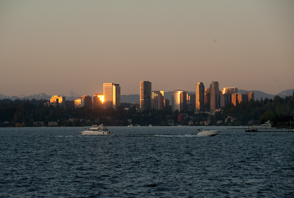 Boats on the water at sunset with the Bellevue skyline in the background in Washington.