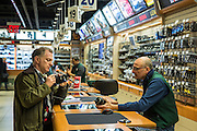 A male customer looks as a camera with a males sales assistant in B&H professional camera shop on 420 9th Avenue, New York City, New York, United States of America.  (photo by Andrew Aitchison / In pictures via Getty Images)