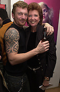 Carl Stanley and Cilla Black. Mick Rock exhibition opening at the Proud Gallery and after party at the Mayfair Club. London. 4 April 2001. © Copyright Photograph by Dafydd Jones 66 Stockwell Park Rd. London SW9 0DA Tel 020 7733 0108 www.dafjones.com