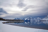Winter Reflection, Coulter Bay. I love the time of year right before the lakes freeze up when I'm lucky enough to be there after a storm.<br />