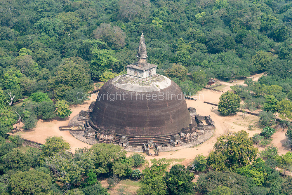 """Rankoth Vehera is a stupa located in the ancient city of Polonnaruwa. The stupa was built by Nissanka Malla, who ruled the country from 1187 to 1196. Rankoth Vehera in Sinhalese, ran means gold, kotha is the name given to the pinnacle of a stupa, and vehera means stupa or temple. Thus, the name Rankoth Vehera can be roughly translated to English as """"Gold Pinnacled Stupa"""