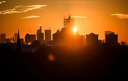 © Licensed to London News Pictures. 03/02/2019. London, UK. The sun rises from behind the City of London, seen from Primrose Hill in North London on a cold winter morning. Large parts of the UK continue to be deluged with snow and freezing temperatures. Photo credit: Ben Cawthra/LNP