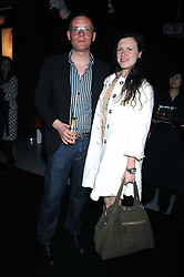 GILES DEACON and KATIE GRAND at the launch of his Gold range for New Look held at their store 500 Oxford Street, London W1 on 12th March 2006.<br />